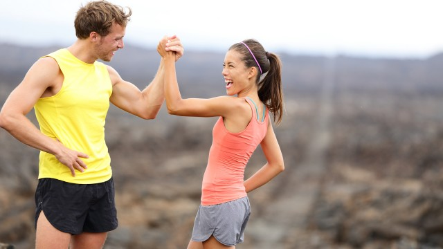 Fitness sport running couple celebrating cheerful and happy givi